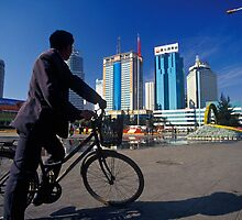 Man on Bicycle and Modern High-rises of Kunming, China (Yunnan)  by Petr Svarc