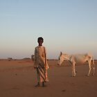 Sudanese boy at dusk by worldbiking