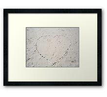 A heart in the Sand Framed Print