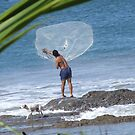 Fisherman throwing net by davidleahy