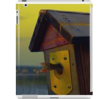A fishtail coming out from a birdhouse entrance iPad Case/Skin