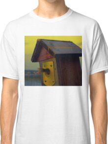 A fishtail coming out from a birdhouse entrance Classic T-Shirt