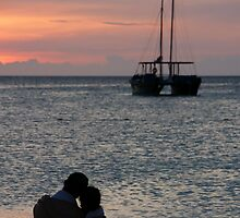 A couple watches the Aruban sunset by AlphaMale912