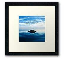 Stone in cold water at sunset Framed Print