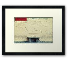 Stone bench, closed shutters and graffiti Framed Print