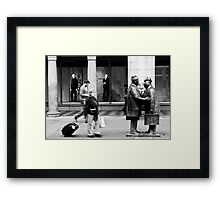The Conversation Amongst the Hustle and Bustle Framed Print