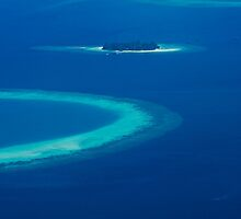 Drone view over North Ari Atolls in the Maldives - Eden on Earth by Digital Editor .