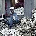Garlic seller - Luxor, Egypt by Anne Kingston