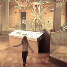 girl in the museum, seeking more dinosaurs by narelle sartain