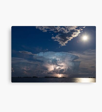 Lightning Striking Thunderstorm Cell and Full Moon Canvas Print