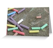 Discarded Color- colored chalks against a cement background Greeting Card