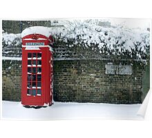 red phone box on a snowy London Poster