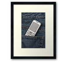 Cellphone in blue jeans Framed Print