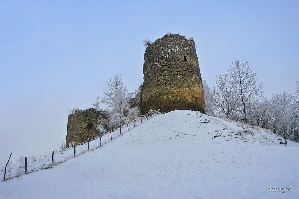 Old medieval fortress on the snowy hill. by demigod