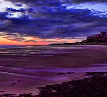 Sunrise Over Bamburgh Castle by Lynne Morris