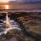 through the gap - sunrise, bawley point, australia by doug riley