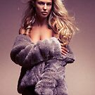 Glamour photo of beautiful woman in fur coat over naked body art photo print by ArtNudePhotos