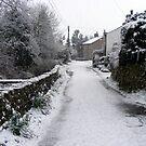 Village snow scene in North Lancashire, England by David Dutton