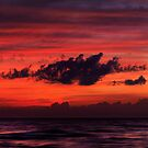 Dark dramatic clouds backlit by beautiful red sunset sky art photo print by ArtNudePhotos