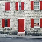 Red shutters in Nassau, Bahamas by Ann Marie Donahue