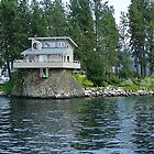 Cabin On A Rock On Coeur D' Alene Lake In Northern Idaho by JaneLoughney