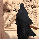 Zagora (Morocco) - woman in maze of alleys by Christine Oakley