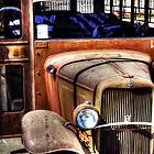 Rusty Old Ford Bus by Terence Russell