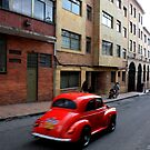 Red Car - Bogota back-streets by Anthony Evans
