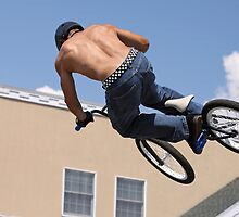 Stunt Biking on a Hot Day by caqphotography