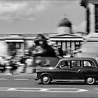 London Cab in Trafalgar Square, London, UK by aldogallery