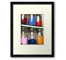 Jars containing coloured sands Framed Print