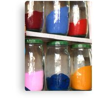 Jars containing coloured sands Canvas Print