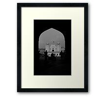 Lahore Fort seen through the arches of Badshahi Mosque Framed Print