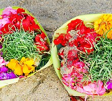 Flower offerings on the beach by Michael Brewer