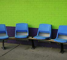 chairs on colorful wall by Lynne Prestebak