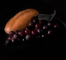 Bread and red grapes by Jeffrey  Sinnock