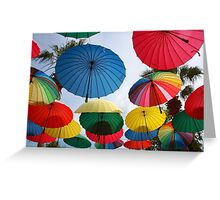 A Shower of Rainbow Coloured Umbrellas Greeting Card