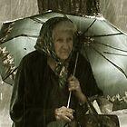 Old lady under rain by cheburashka