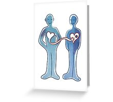 A couple standing with connected hearts Greeting Card