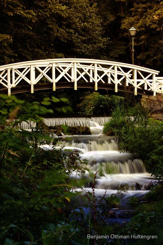 Bridge over waterfall by Benjamin Othman Hultengren