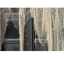 A fish net on the door Photographic Print