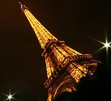 The crown jewel of Paris, the Eiffel Tower, as seen by night by benjaminralston