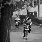 Man Commuting on a Bike by Aric Berger