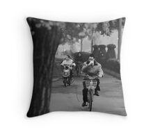 Man Commuting on a Bike Throw Pillow