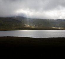Sun rays break through cloud, Iceland by hinomaru
