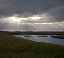 Sun rays breaking through cloud over Brei∂afjör∂ur, Iceland by hinomaru