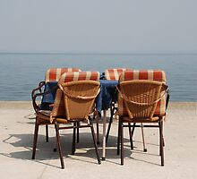 Chairs and Table at Seafront  by jojobob