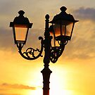 Lamp illuminated by the setting sun by Christine Oakley