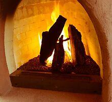 Adobe fireplace by Thad Zajdowicz