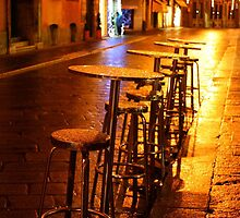 Reggio-Emilia. Tables and Chairs from a Cafe at Night. Italy 2009 by Igor Pozdnyakov